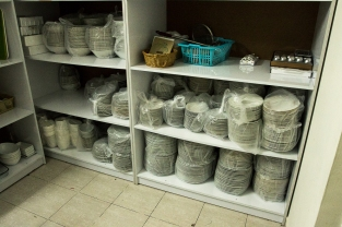 Dishes cleaned and stored on shelves